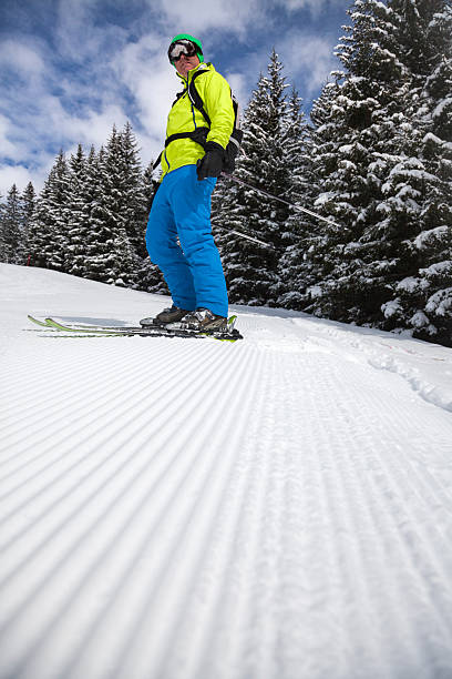skier on freshly groomed slope - corduroy stock pictures, royalty-free photos & images