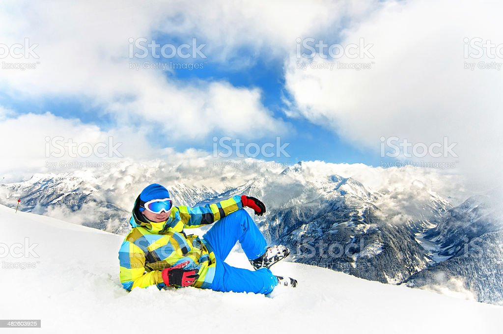 Skier on top of mountains with snow and ski equipment stock photo