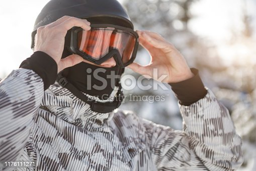 Skier preparing for skiing