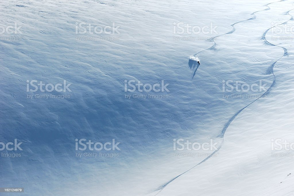 Skier riding down the slope stock photo