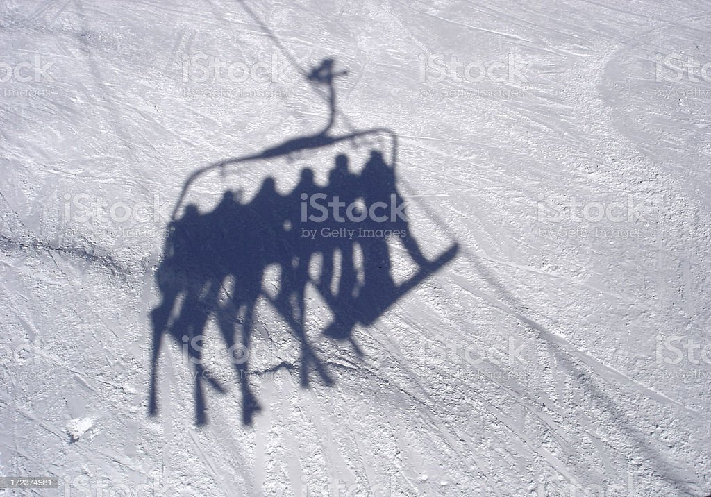 Skier Riding the Chairlift royalty-free stock photo