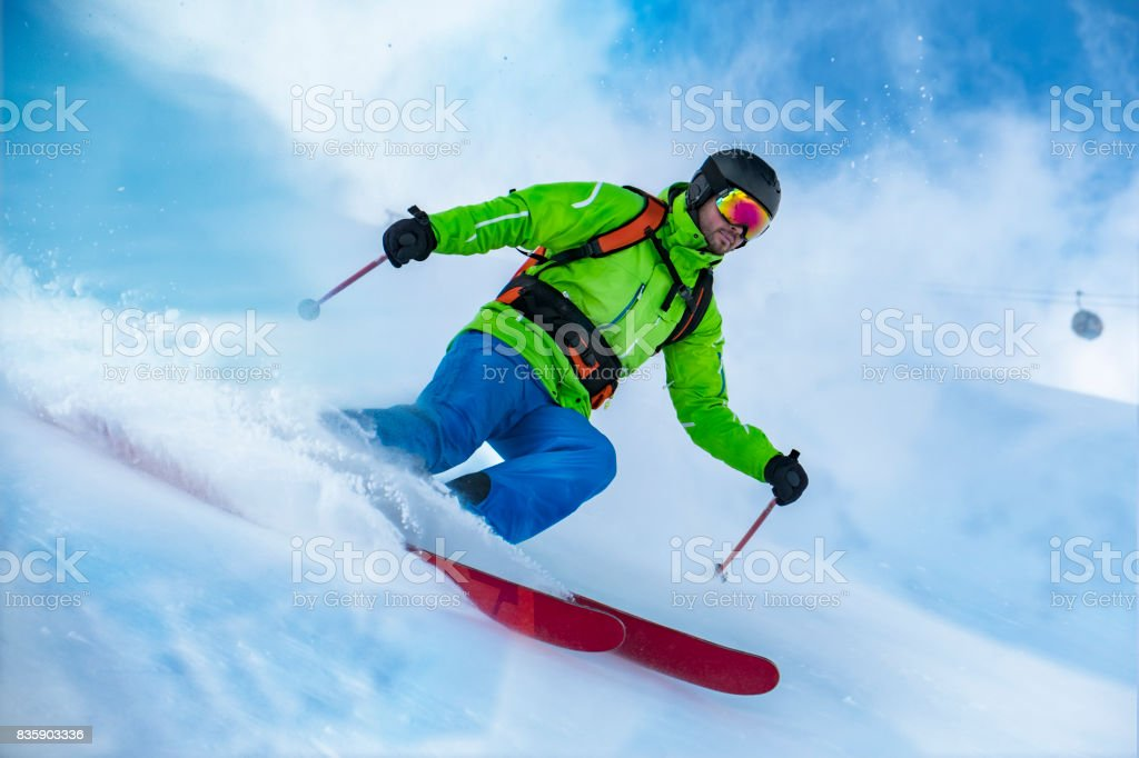 Skier riding the snow wave stock photo