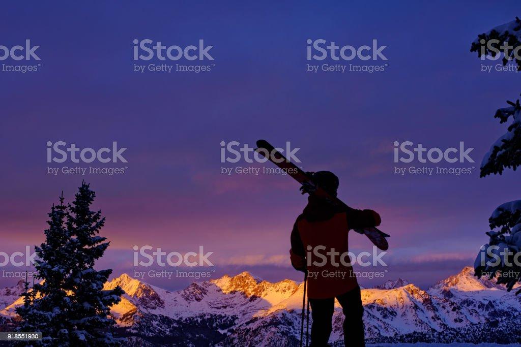 Skier Silhouette and Mountain Alpenglow stock photo