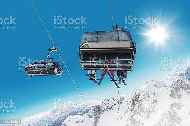 Skier Sitting At Ski Lift Stock Photo - Download Image Now