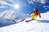 Skier skiing downhill against famous Matterhorn peak in Switzerland
