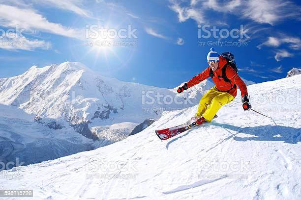 Skier skiing downhill against matterhorn peak in switzerland picture id598215726?b=1&k=6&m=598215726&s=612x612&h=gznbnz2berkbss6yrgm3db5wvsstoww2nb2ilp0r8ca=