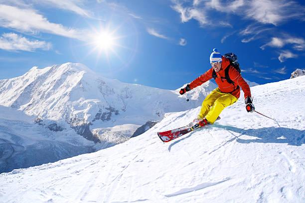 Skier skiing downhill against matterhorn peak in switzerland picture id598215726?b=1&k=6&m=598215726&s=612x612&w=0&h=6wgyb82elvzuljccxjiwkbgie rva82j5priizlodzy=
