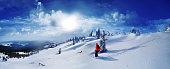 Skier skiing downhill in high mountains against sunset,Dragobrat,Ukraine