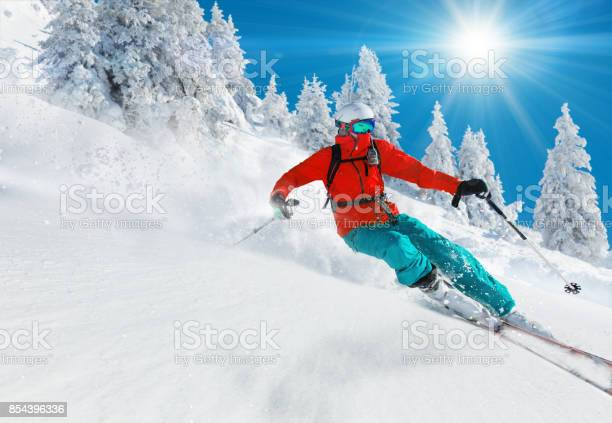 Skier skiing downhill in high mountains picture id854396336?b=1&k=6&m=854396336&s=612x612&h=fd2na kqitm qqj6e6eo57jdhkr0rxwckv0itkm32e4=