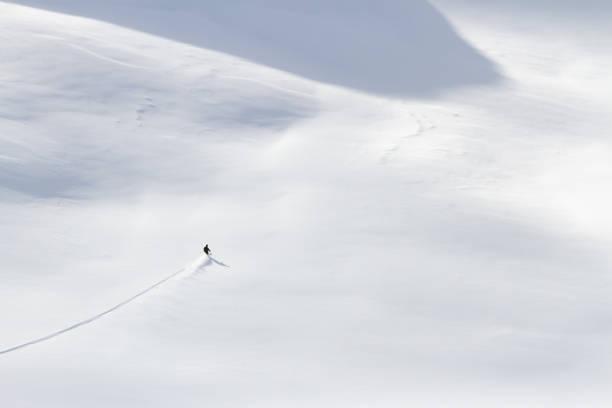 Skier skiing offpiste in powder snow picture id1045322232?b=1&k=6&m=1045322232&s=612x612&w=0&h=hcoxfuocya 1jegehfidmbbnsvghfth76qcooxxp4ha=