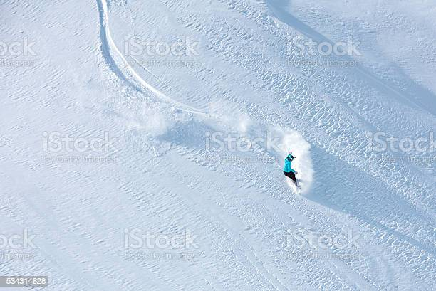 Skier skiing offpiste on a beatiful mountain slope picture id534314628?b=1&k=6&m=534314628&s=612x612&h=f1gnwj7tuawx0orivpbbc vvilyiiqvnejckpvybeag=