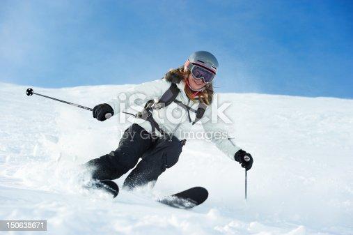 istock Skier skiing on snowy slope 150638671