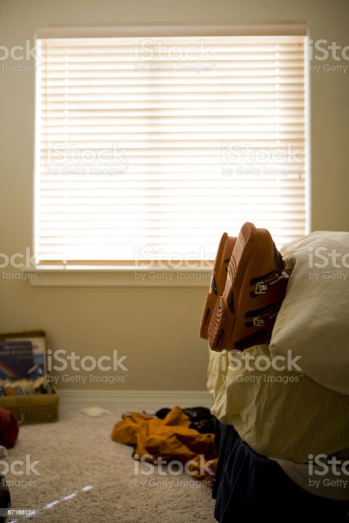 A skier sleeping with his ski boots on. royalty-free stock photo