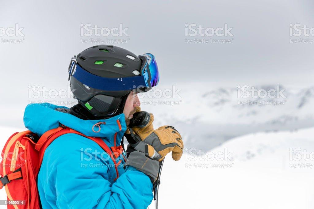 Skier Snowboarder Using Walkie Talkie in Backcountry Area stock photo