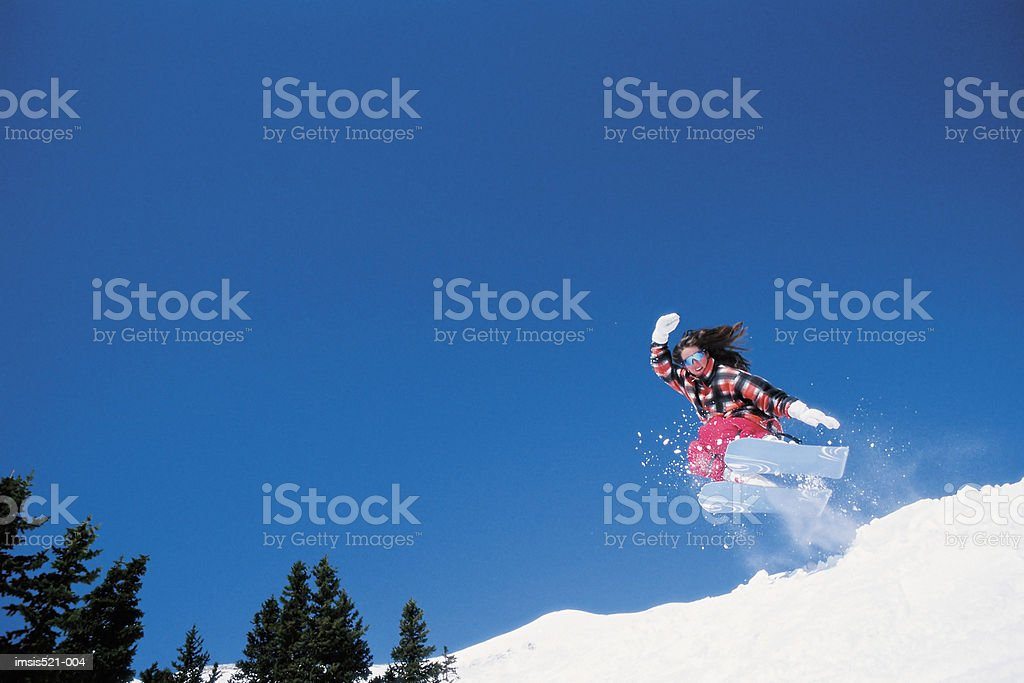 Skier speeding downhill 免版稅 stock photo