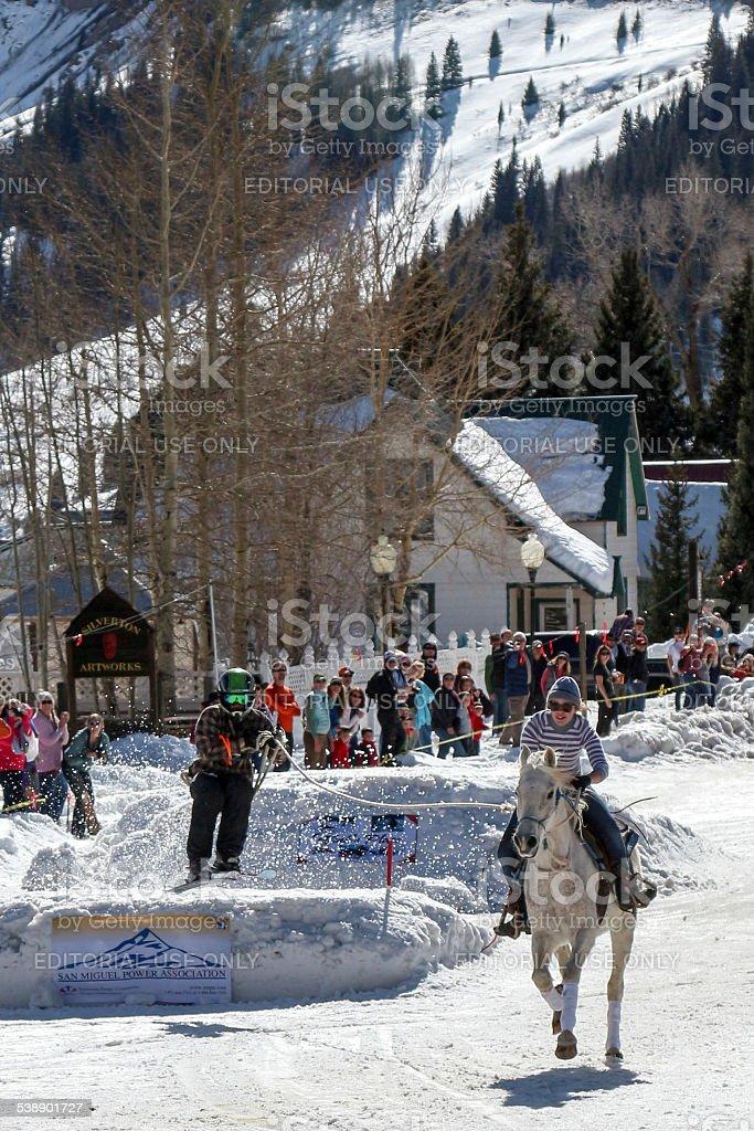 Skier takes off, Silverton Skijoring Novice Division race stock photo