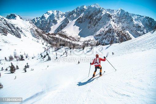 Men ski touring in the mountains on snow, exploring the Dolomite.