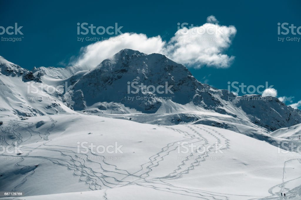 Skier tracks in deep snow stock photo
