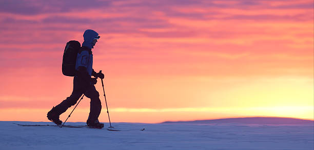 Skier walking on the mountain stock photo