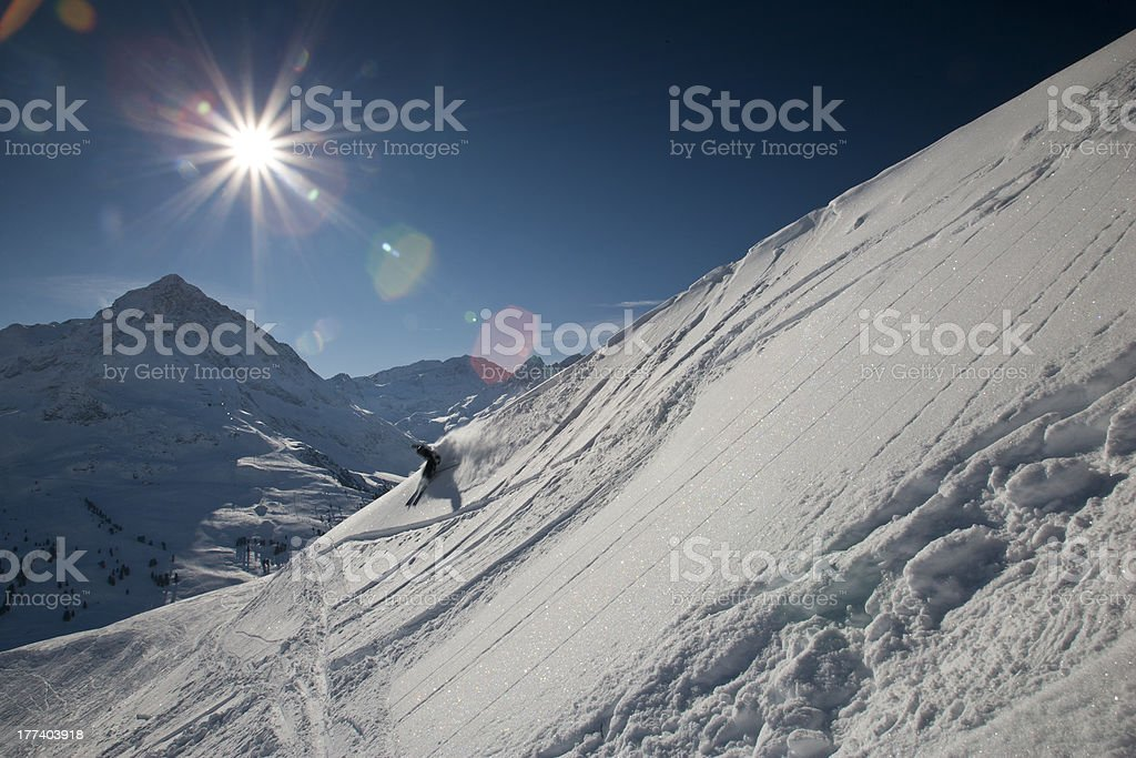 Skier with sun and mountains in Tirol stock photo