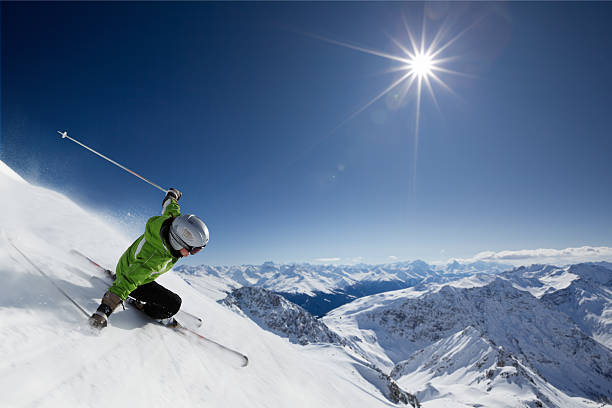 skier with sun and mountains - skidpist bildbanksfoton och bilder