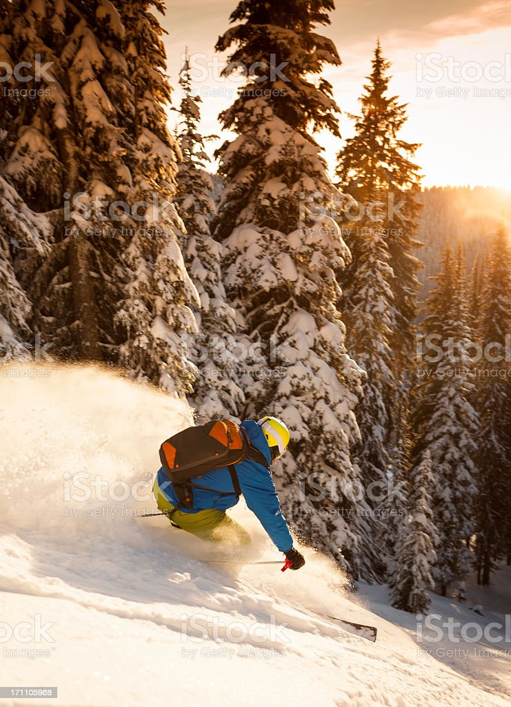 Skier zooming down the through the powder royalty-free stock photo