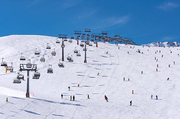 skiers and chairlifts in solden, austria - skidpist bildbanksfoton och bilder