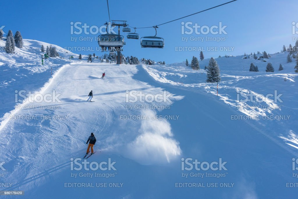 Skiers and ski lift on the Zillertal Arena track stock photo