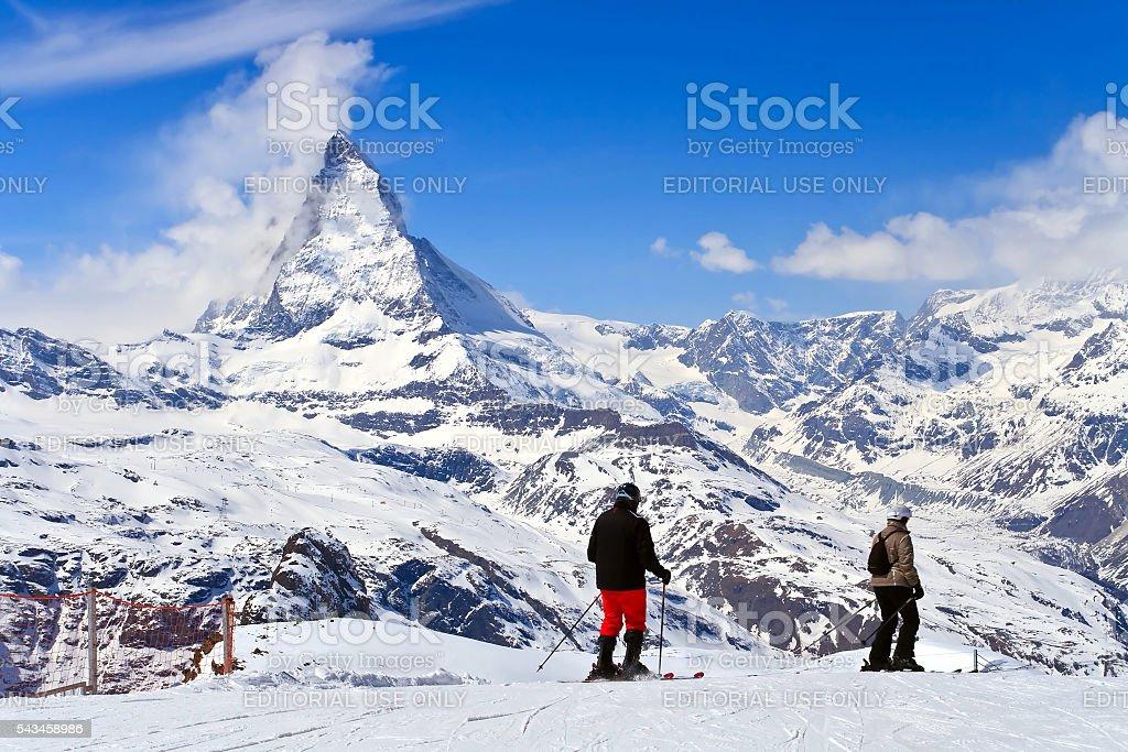 Skiers at Matterhorn Switzerland stock photo