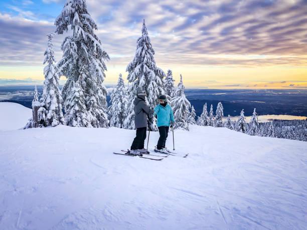 Skiers at top of ski run sunset view of city picture id1124925485?b=1&k=6&m=1124925485&s=612x612&w=0&h=hfdfyhgwvg1qnkz23l xjopfgqwqi1gvsdgtyyfxugm=