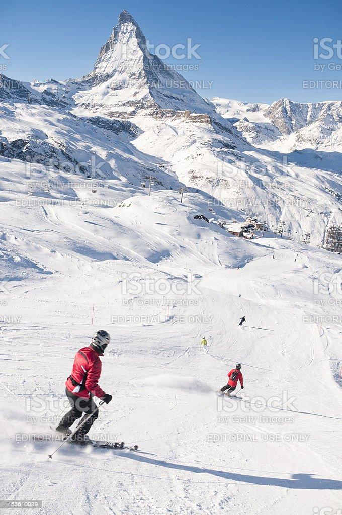 Skiers at Zermatt in Switzerland stock photo