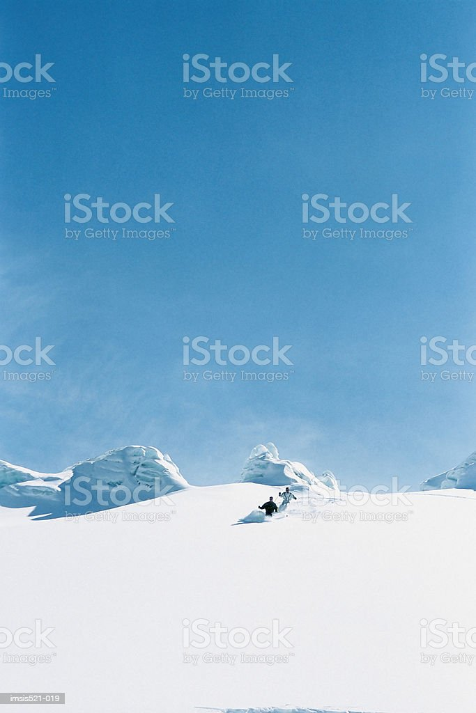 Skiers breaking virgin snow royalty free stockfoto