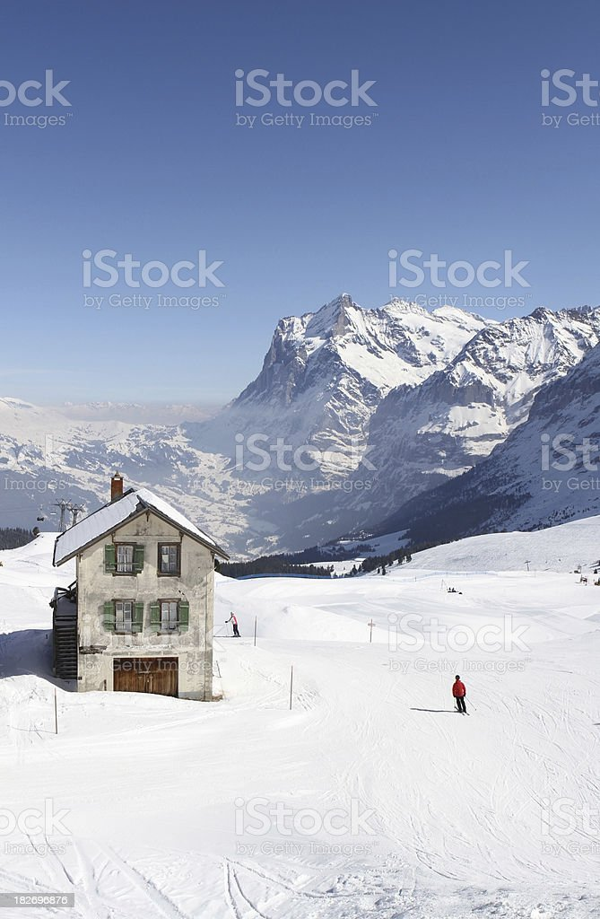 Skiers descending from the Kleine Scheidegg plateau, Berne Canton royalty-free stock photo