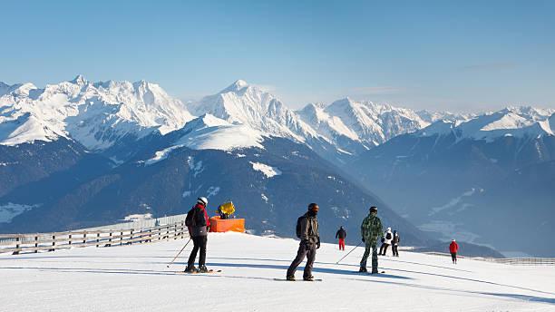 Skiers Enjoy Fantastic Alpine Panorama stock photo