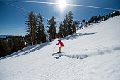 Skiers play and rip lines in Truckee, California mountains