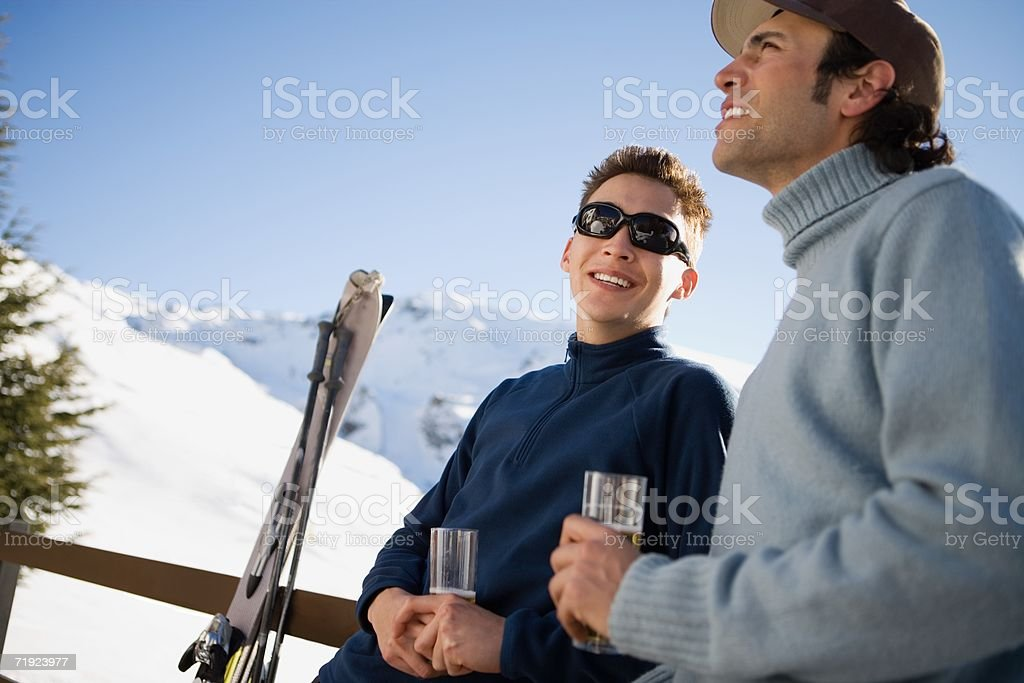 Skiers having a drink royalty-free stock photo