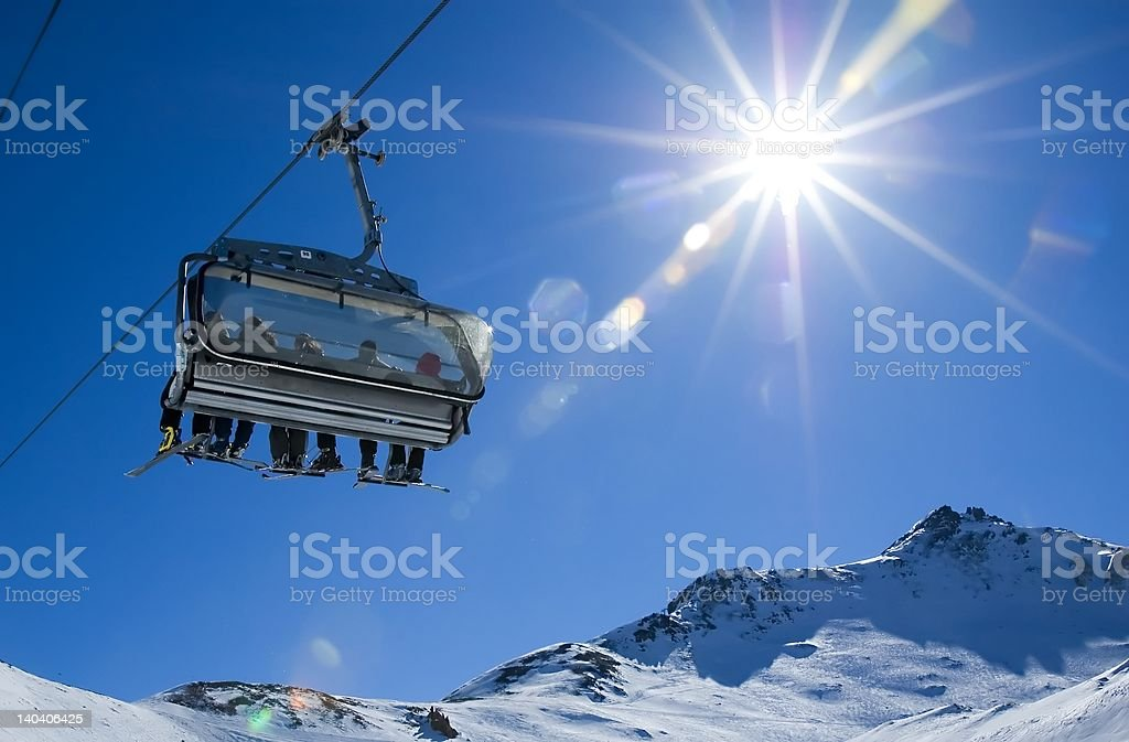 skiers in a chairlift stock photo