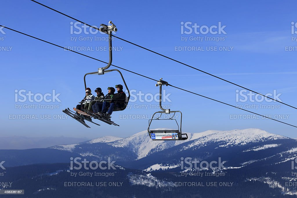 skiers in a ski lift at Spindleruv Mlyn stock photo