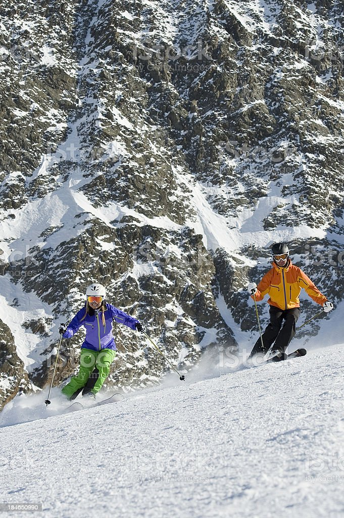 Skiers in extreme situation stock photo