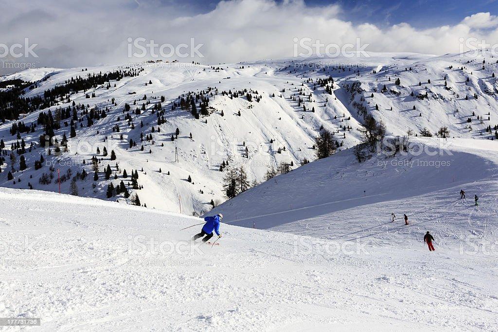 Skiers in Passo Campolongo near Skiing Resort of Arabba stock photo