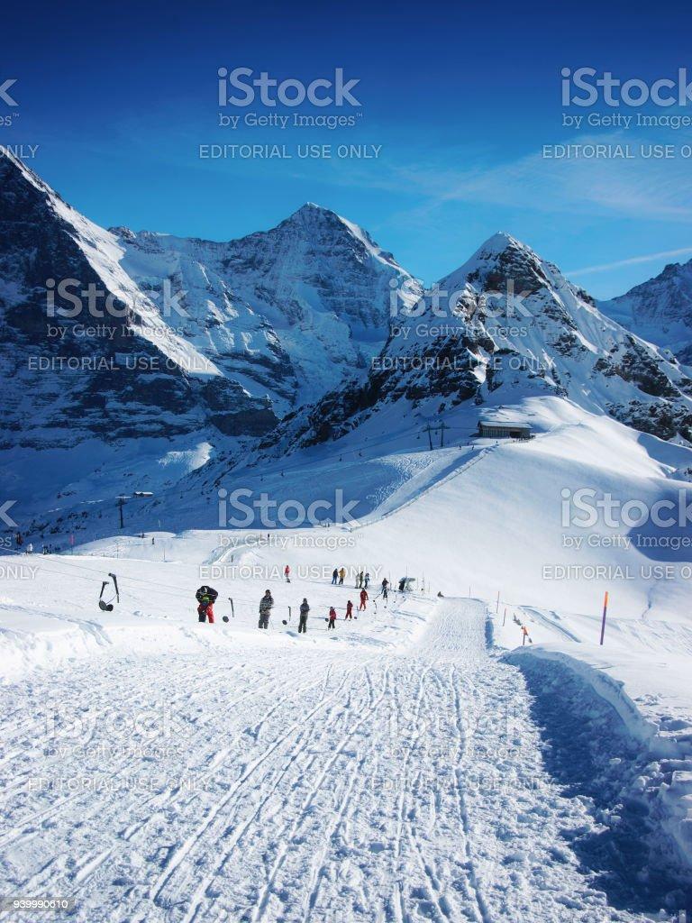 Skiers in winter sport resort swiss alps maennlichen stock photo skiers in winter sport resort swiss alps maennlichen royalty free stock photo publicscrutiny Gallery