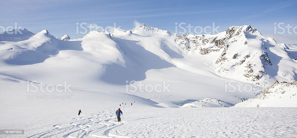 Skiers on a glacier completely covered with deep snow. royalty-free stock photo
