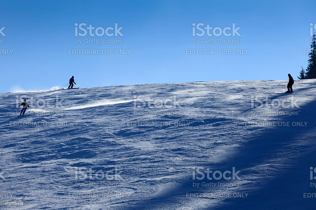 skiers on a ski slope in the Czech Republic stock photo