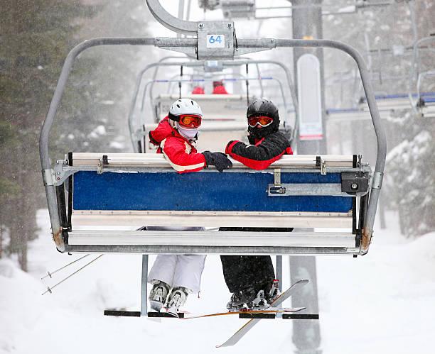 Skiers on a ski-lift stock photo
