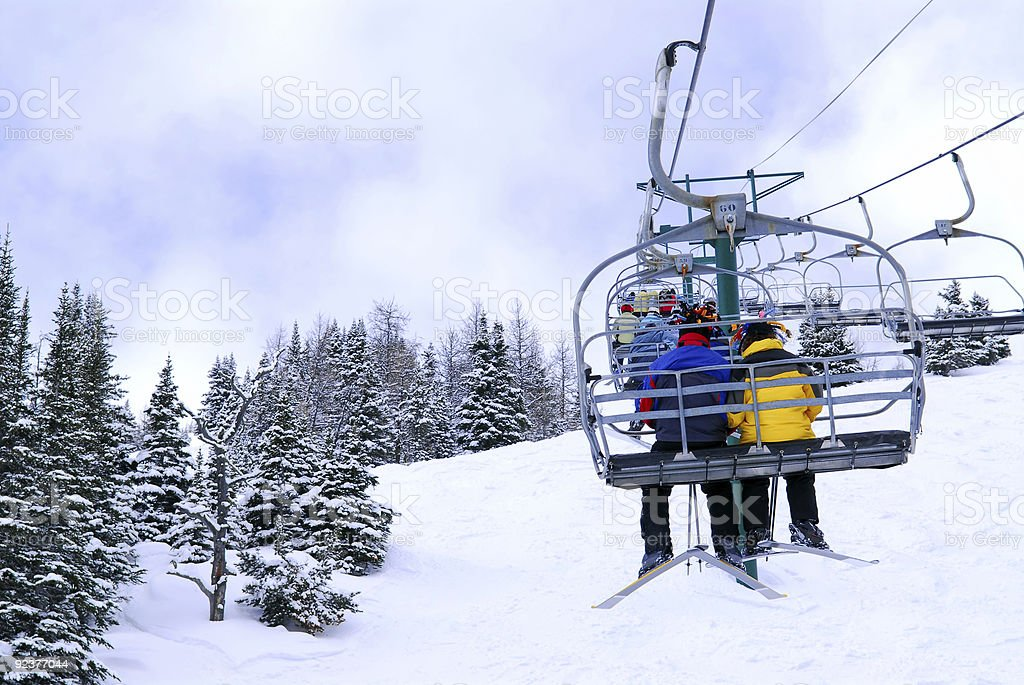 Skiers on chairlift royalty-free stock photo