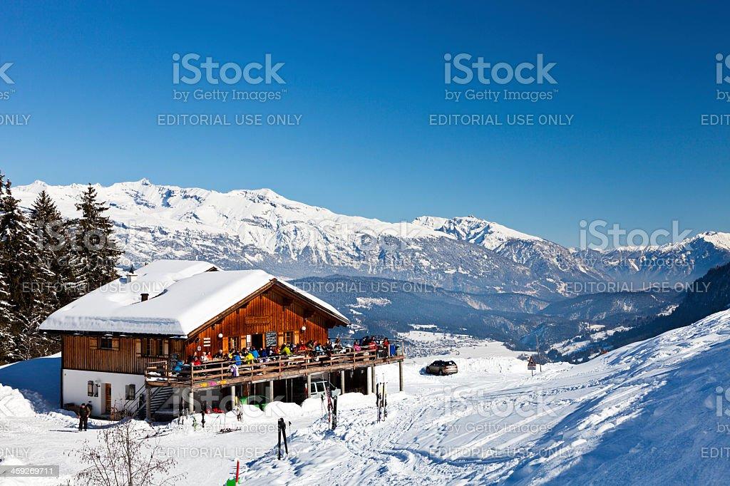 Skiers on lunch break stock photo