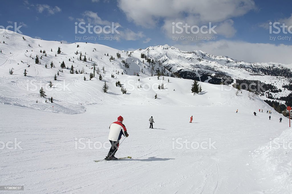 Skiers on slope in Dolomiti royalty-free stock photo