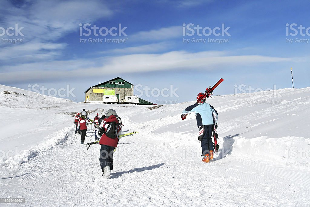 skiers on the montain royalty-free stock photo