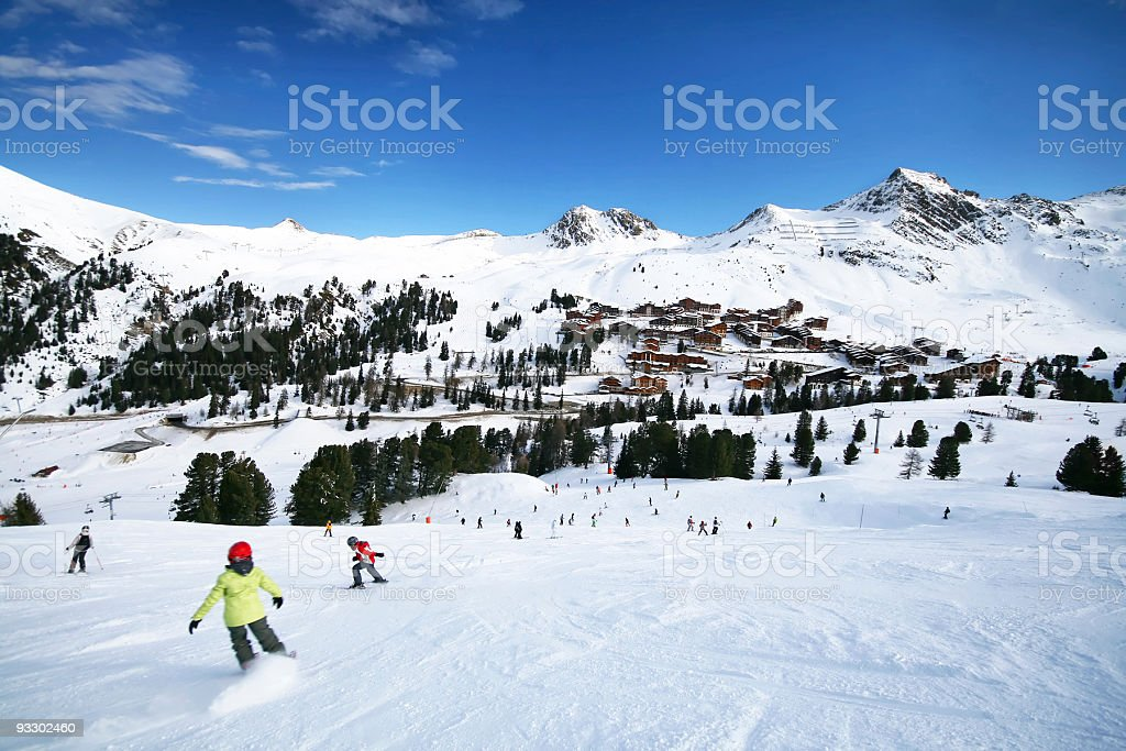 Skiers on the snowy and rocky Alps royalty-free stock photo