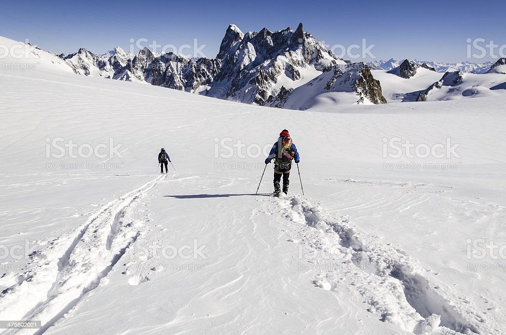 Skiers on Vallee Blanche stock photo